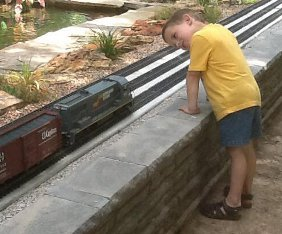 Boy looking down track.
